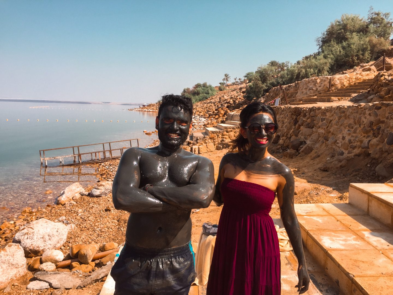 Slathered in mud pack in Dead Sea Jordan